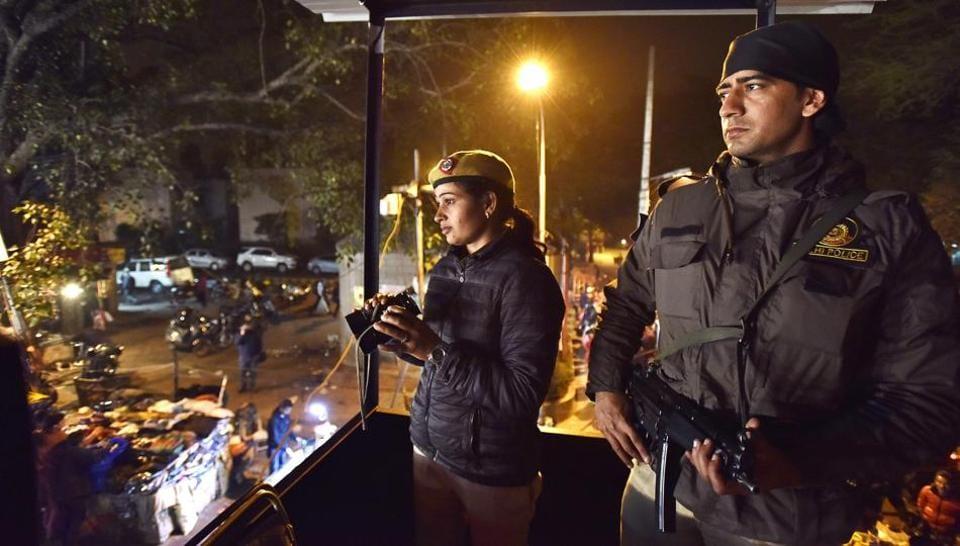 Delhi Police officials guard Sarojini Nagar market on the eve of Republic Day.