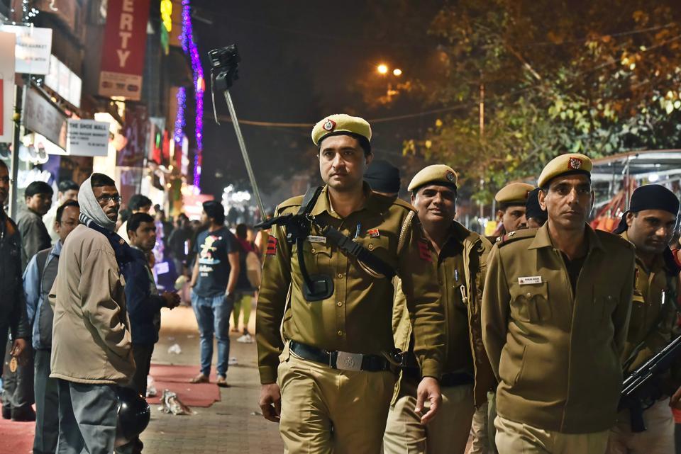 Delhi Police personnel maintain vigil at the popular Sarojini Nagar market ahead of Republic Day.