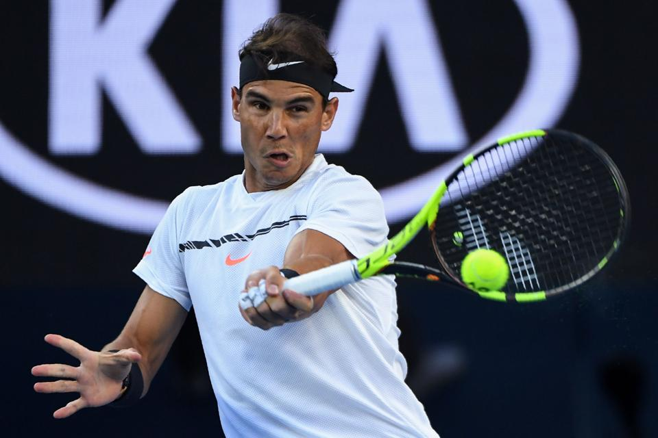 Rafael Nadal defeated Milos Raonic 6-4, 7-6 (9/7), 6-4 in their men's singles quarter-final match. (AFP)