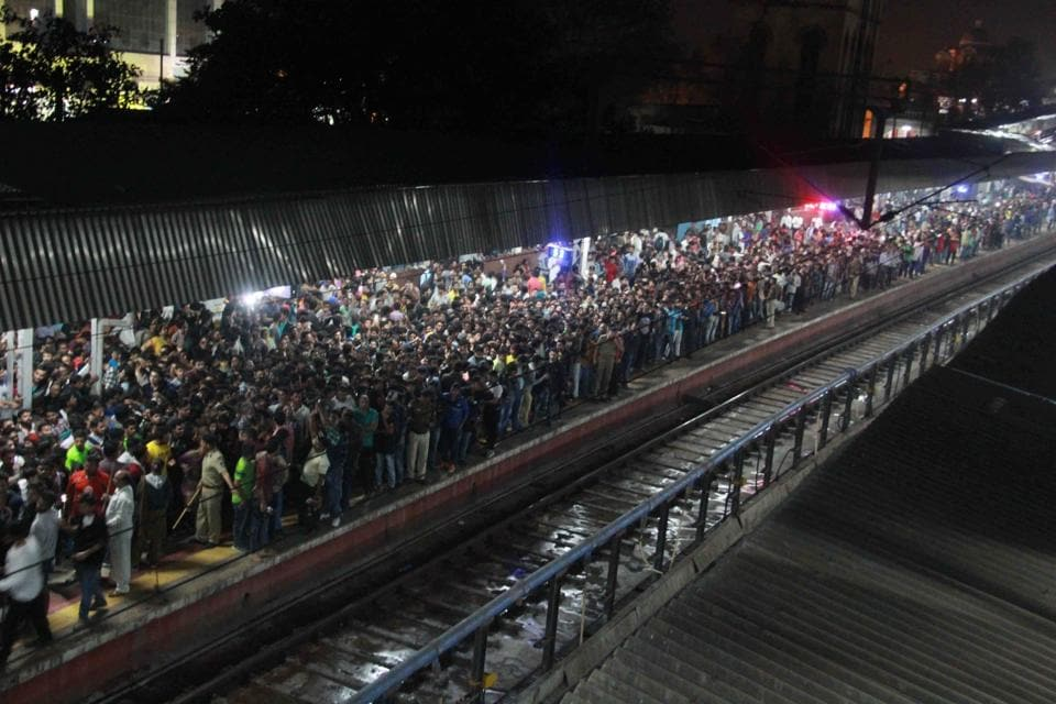 People throng Vadodra railway station to get a glimpse of actor Shah Rukh Khan on Monday.