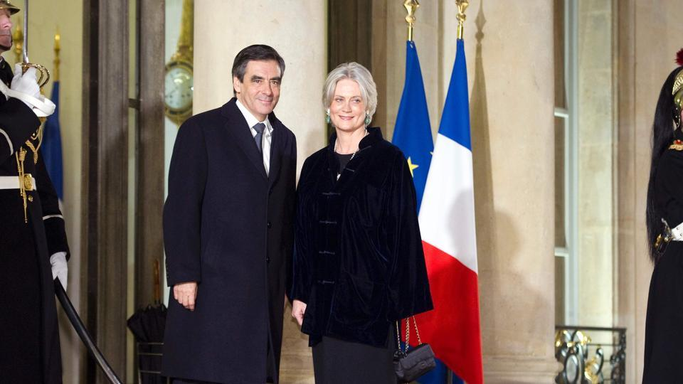 (This file photo taken on January 26, 2012 shows French Prime Minister Francois Fillon and his wife Penelope arriving for a state dinner with Ivory Coast President Alassane Dramane Ouattara, at the Elysee Palace in Paris.