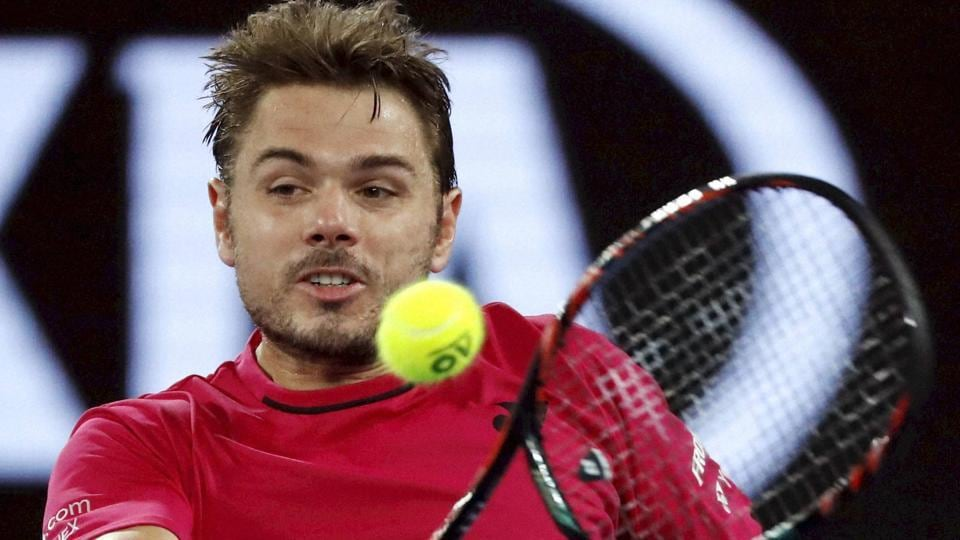 Stan Wawrinka makes a backhand return to compatriot Roger Federer during their semifinal at the Australian Open. (AP)