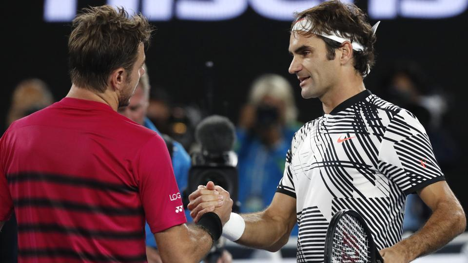 Switzerland's Roger Federer, right, is congratulated by compatriot Stan Wawrinka. (AP)