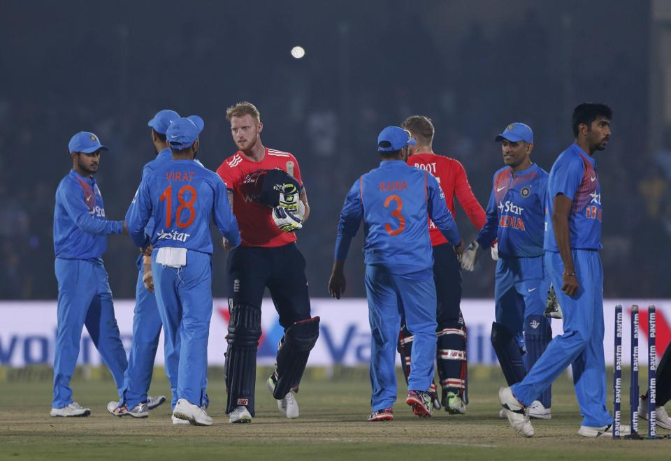 England's Ben Stokes shakes hand with India's captain Virat Kohli and other players after beating India in the their first Twenty20 cricket match at Green Park stadium in Kanpur, India, Thursday, Jan. 26, 2017. (AP Photo/Altaf Qadri)