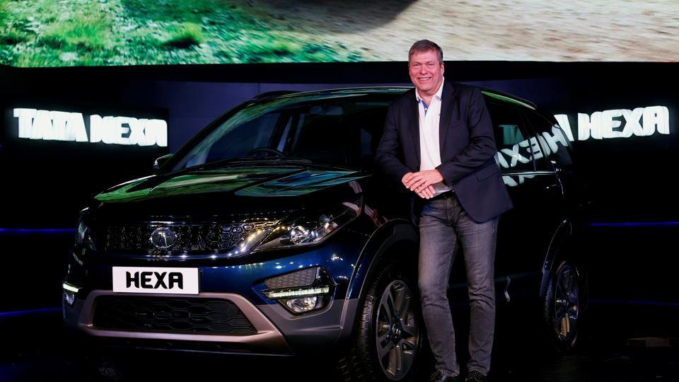 Tata Motors' CEO and managing director Guenter Butschek poses with a Hexa car during its launch in Mumbai.