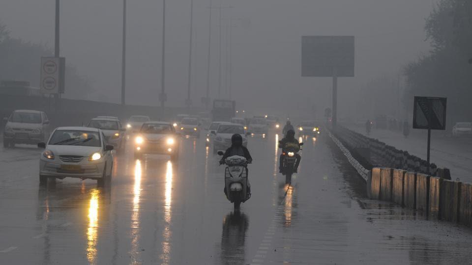 Vehicles plying in the rain on the Delhi-Gurgaon Expressway on Thursday.