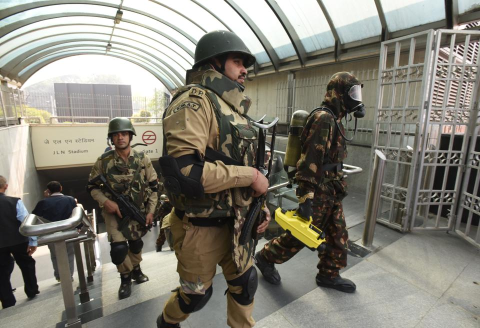 CISF personnel conduct a mock drill at the Jawaharlal Nehru stadium Metro station. Delhi was on high alert due to the Republic Day celebrations.