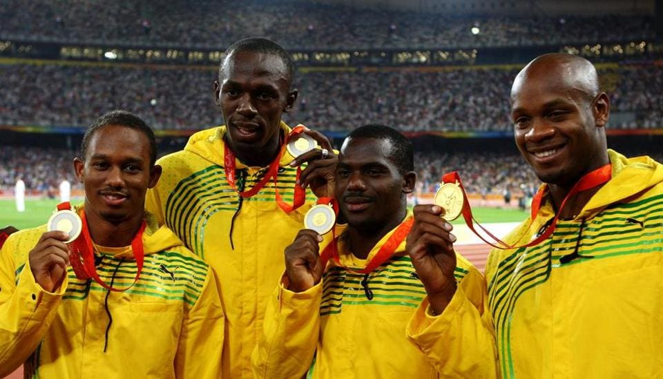 (left to right) Michael Frater, Usain Bolt, Nesta Carter and Asafa Powell receive their gold medals after the Jamaican quartet won the 4x100m relay gold with a world record at the 2008 Beijing Olympics.  Carter's positive in a re-test has led to Bolt losing one of his nine gold medals.