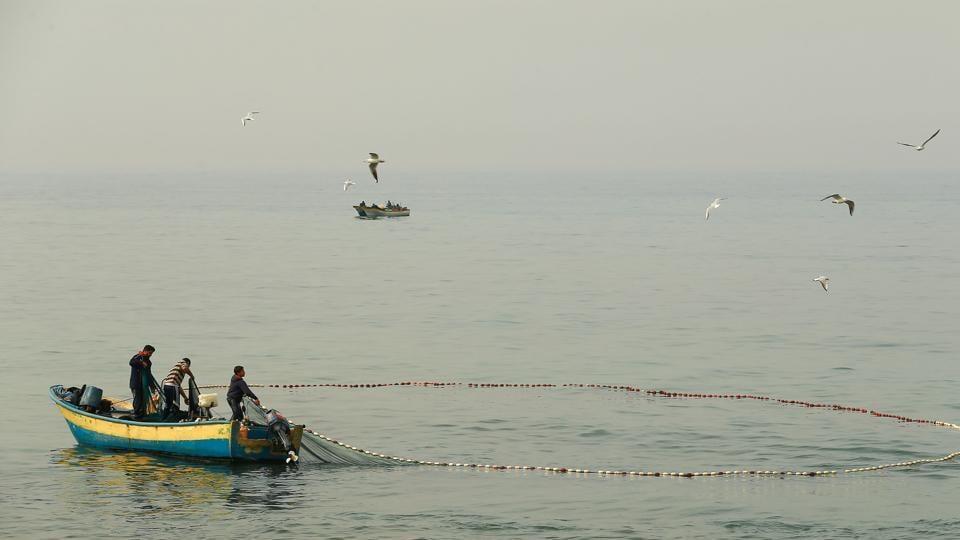 The fishermen were apprehended near the International Maritime Boundary Line.
