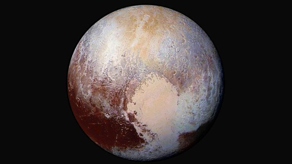 This image made available by NASA on July 24, 2015 shows a combination of images captured by the New Horizons spacecraft with enhanced colors to show differences in the composition and texture of Pluto's surface. It took the spacecraft about 16 months to beam back all of its data from the Pluto flyby.