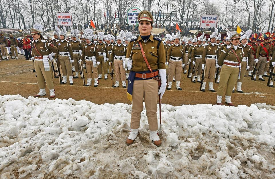 The women contingent of Jammu and Kashmir Police stand at attention during the 68th Republic Day parade at the Bakshi Stadium in Srinagar on Thursday.