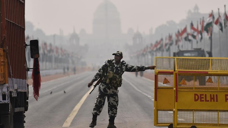 Security personnel on alert at Rajpath on the eve of Republic Day celebration in New Delhi on Wednesday.