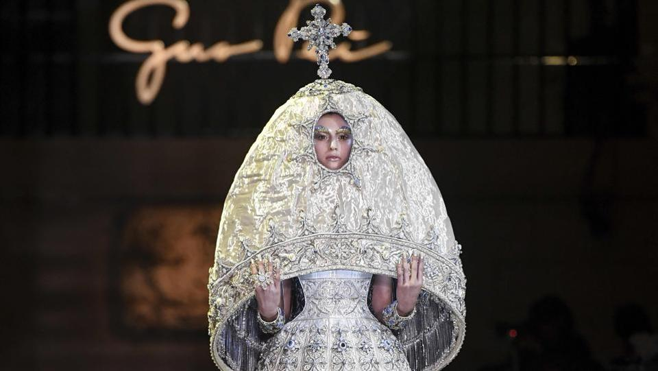 A model presents a creation by Guo Pei during the 2017 spring/summer Haute Couture collection on Thursday. (AFP)