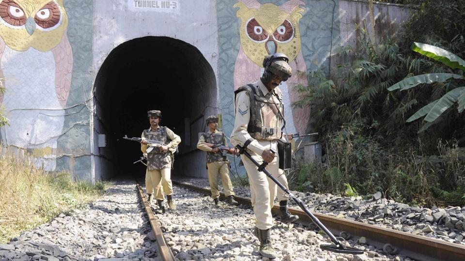 Paramilitary force personnel search part of the railway track on the eve of the country's Republic Day celebrations in the Baramura hill range near Agartala on Wednesday.