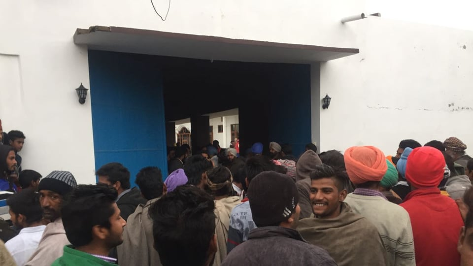 Villagers outside a house where SGPC member Mandwala was reportedly sitting inside.