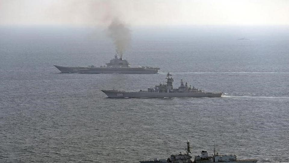HMS St Albans (front) monitors Russian warships Pyotr Velikiy and the Admiral Kuznetsov (rear) as they pass close to UK territorial waters, in this photograph released in London on January 25.