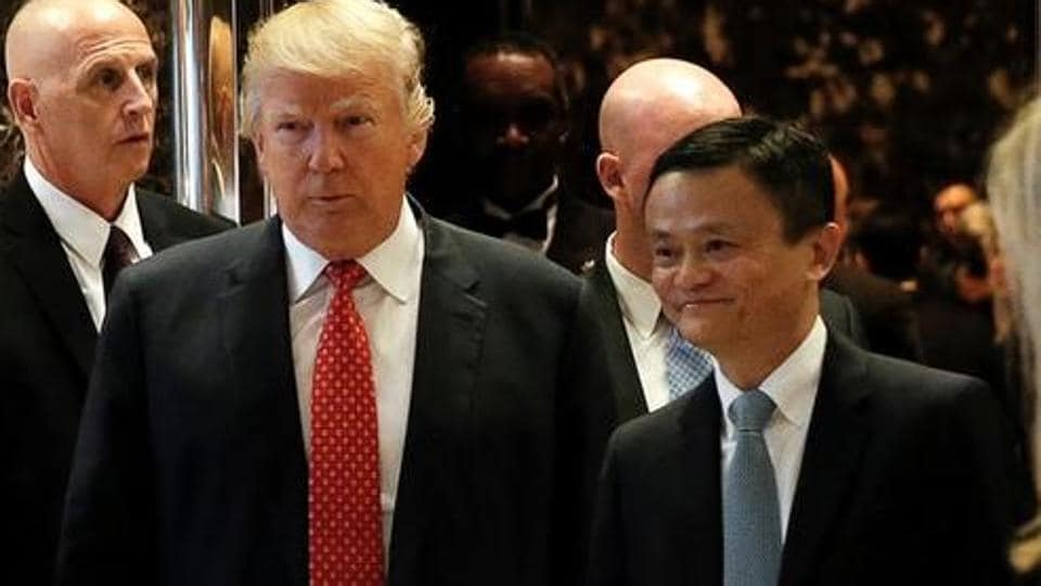 UUSPresident-elect Donald Trump walks from an elevator with Alibaba Executive Chairman Jack Ma after their meeting at Trump Tower in New York, U.S., January 9, 2017.
