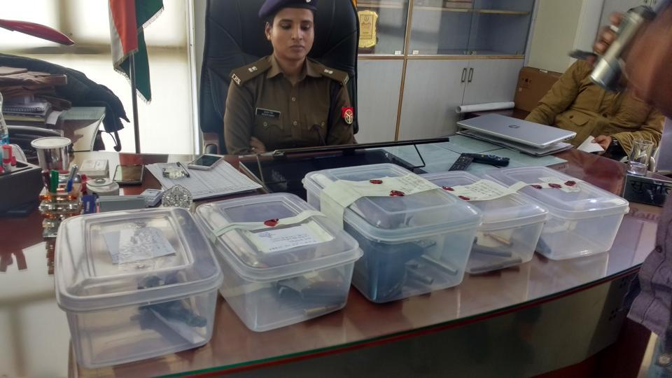The police seized ₹20 lakh unaccounted cash, illegal guns and over 300 cartons of liquor.