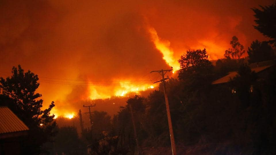 A forest fire burns out of control in Santa Olga.