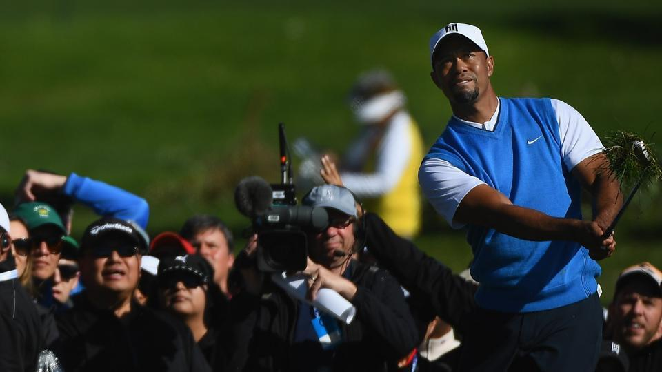 Tiger Woods chips onto the second green during the first round of the Farmers Insurance Open at Torrey Pines South on Thursday.