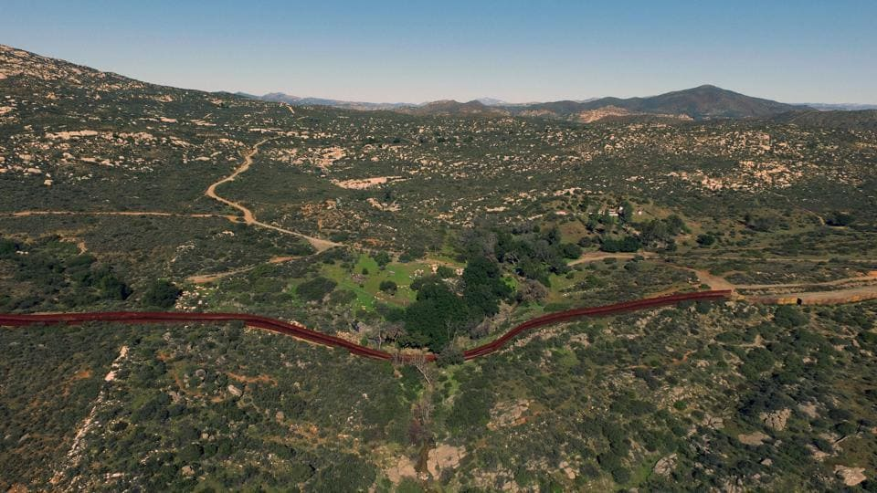 An aerial view  shows the urban fencing on the border between the US and Mexico in Tecate, northwestern Mexico, on Thursday.
