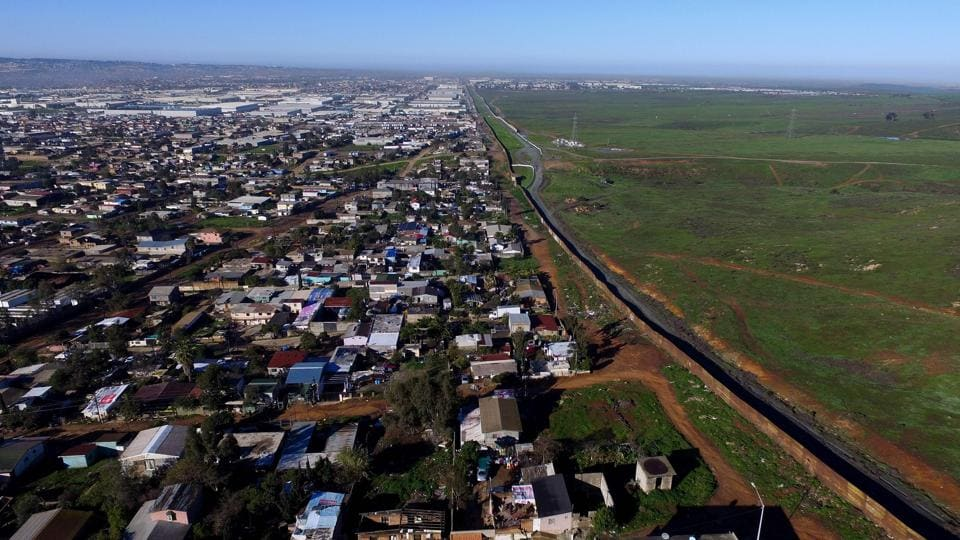 Aerial picture taken with a drone of the urban fencing on the border between the US and Mexico at El Nido del Aguila, outskirts of Tijuana, northwestern Mexico