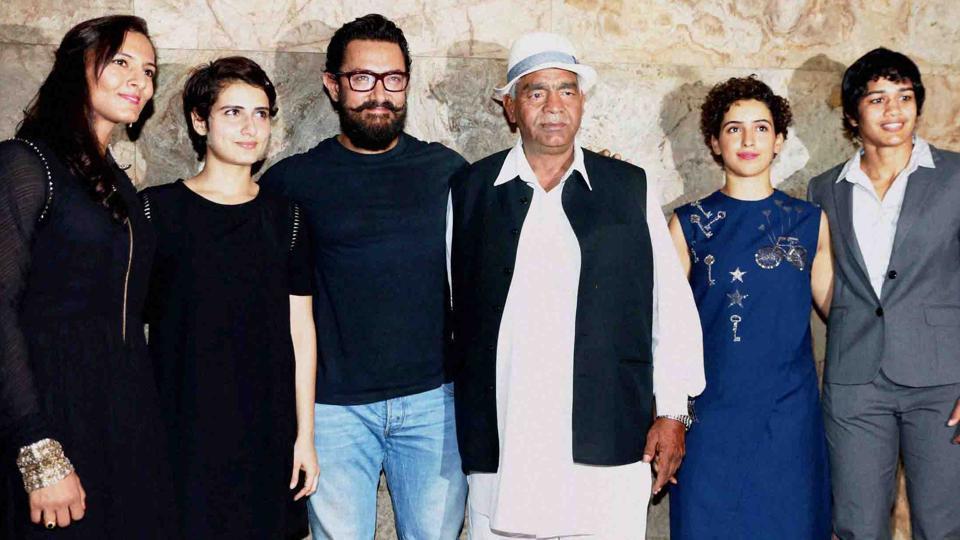 (L to R) Geeta Phogat, bollywood actors Fatima Sana Shaikh, Aamir Khan, Mahavir Singh Phogat, actor Sanya Malhotra and Babita Kumari during the special screening of film Dangal in Mumbai.
