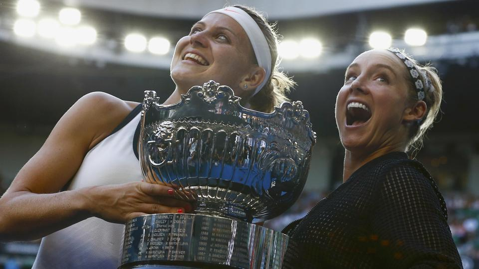 Bethanie Mattek-Sands of the US and Czech Republic's Lucie Safarova with the trophy after winning the Australian Open women's doubles final against Czech Republic's Andrea Hlavackova and China's Peng Shuai in Melbourne on Friday.