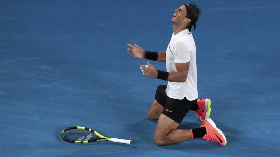Rafael Nadal falls onto the court as he celebrates after defeating Grigor Dimitrov in Australian Open semi-final.