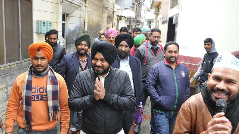 AAP candidate from Batala Gurpreet Singh Waraich campaigning ahead of elections on Wednesday.