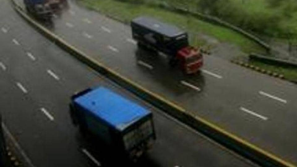 Two people were killed after a man ran over them with his car on the Mumbai-Pune Expressway when the two were crossing the road on Friday night.