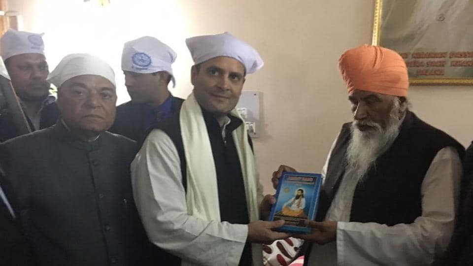 Sect of Dera Sach Khand Ballan Sant Niranjan Dass honouring AICC vice-president Rahul Gandhi in Jalandhar on Saturday.