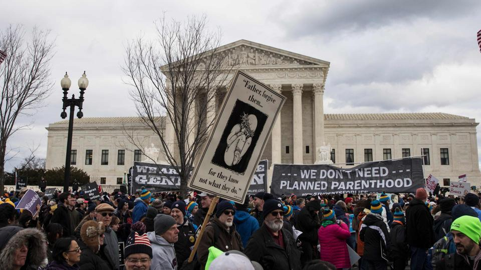 Pro-life demonstrators protest in front of the US Supreme Court during the 44th annual March for Life in Washington, DC, on Friday. Anti-abortion advocates descended on the US capital on Friday for an annual march expected to draw the largest crowd in years, with the White House spotlighting the cause and throwing its weight behind the campaign.