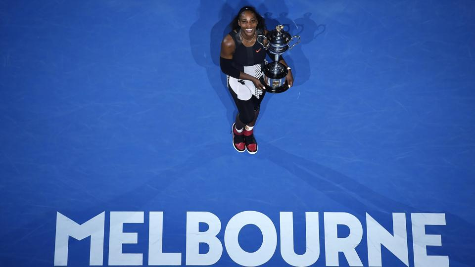 Serena Williams gives the perfect pose with the Australian Open trophy on Saturday. (AP)