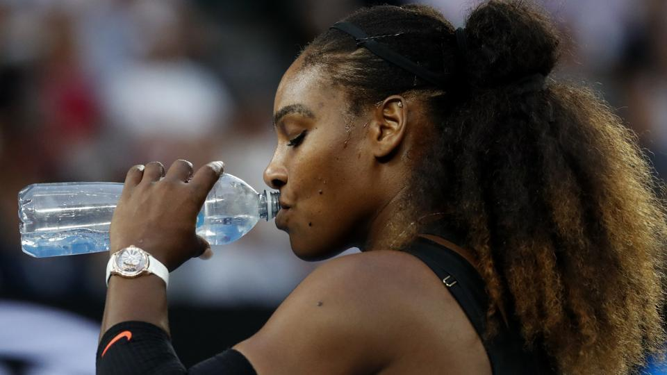 Serena Williams takes a drink during a break in her final against sister Venus. (AP)