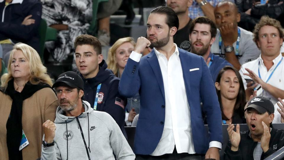Alexis Ohanian (centre), fiance of Serena Williams, and other supporters in her player box react during the final in Melbourne on Saturday. (AP)