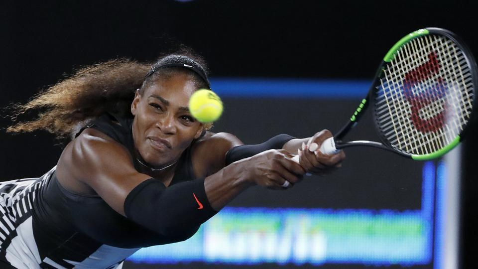 Serena Williams reaches for a a backhand during the women's final against Venus on Saturday. (AP)