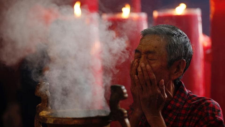 A man prays during Lunar New Year celebrations at Dharma Bhakti temple in Jakarta, Indonesia. (Darren Whiteside/REUTERS)