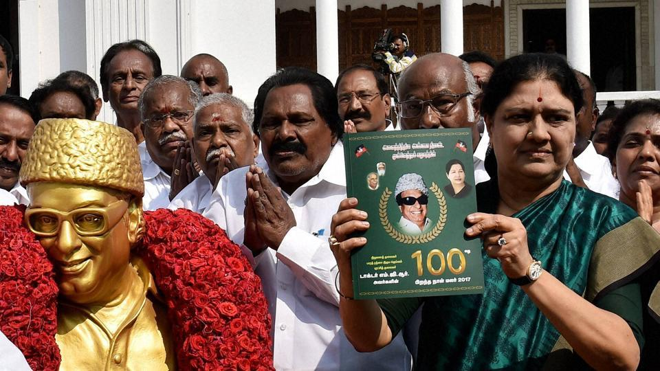 AIADMK general secretary VK Sasikala releases manifesto of party founder the late M G Ramachandran on his 100th birth anniversary celebration, at party headquarters in Chennai on Tuesday.