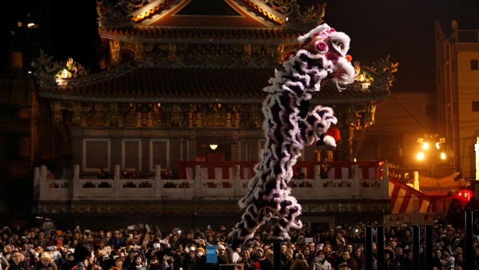 Dancers perform a lion dance in front of a temple as they celebrate the Lunar New Year in China Town, in Yokohama, south of Tokyo, Japan. (/Kim Kyung-HoonREUTERS)