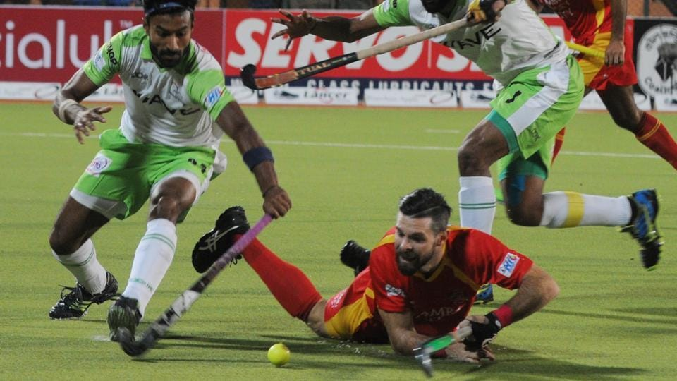 Ranchi Rays (red jersey) and Delhi Waveriders players vie for the ball during their Hockey India League match in Ranchi on Saturday.