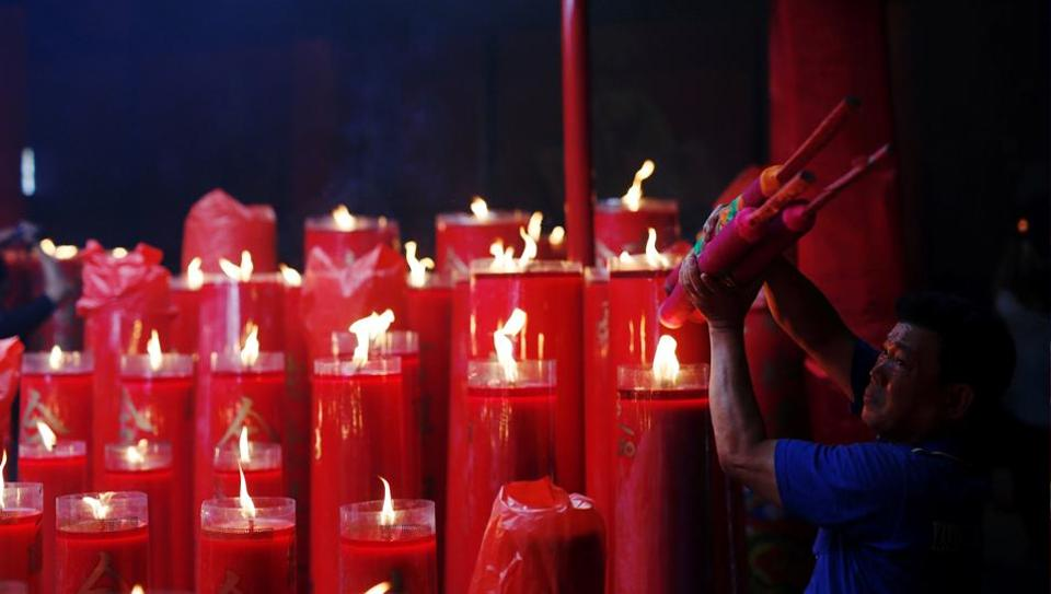 A man lights incense sticks during Lunar New Year celebrations at Dharma Bhakti temple in Jakarta, Indonesia. (Darren Whiteside/REUTERS)