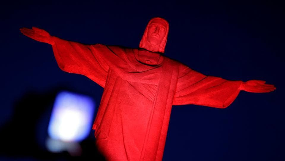 The statue of Christ the Redeemer is illuminated in red in honor of the Chinese Lunar New Year in Rio de Janeiro, Brazil. (Ueslei Marcelino/REUTERS)