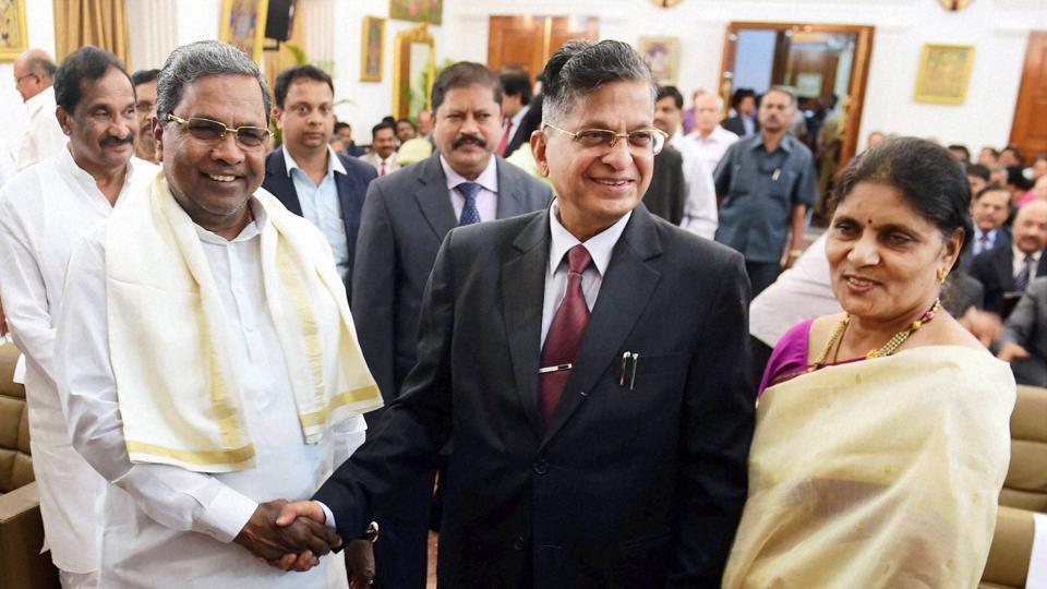Karnataka chief minister Siddaramaiah greets Lokayukta Justice P Vishwanath Shetty and his wife during the swearing ceremony at Raj Bhavan in Bengaluru.