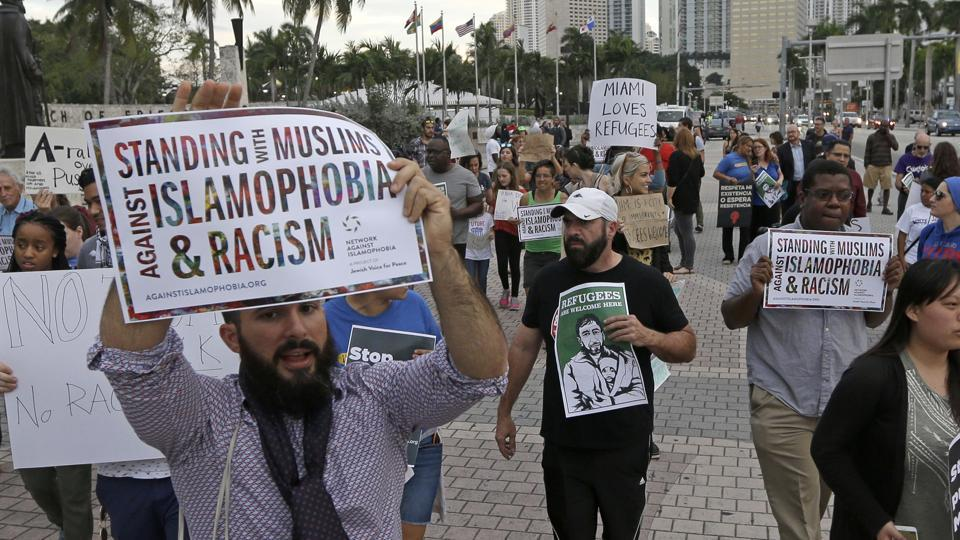 Protesters chant slogans against President Donald Trump's executive order on Muslim immigration, in downtown Miami.
