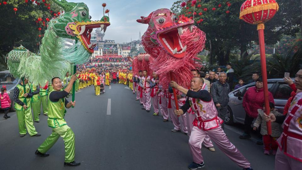 People perform a dragon dance to celebrate China's Lunar New Year in Dabu County, Guangdong province, China. (REUTERS)