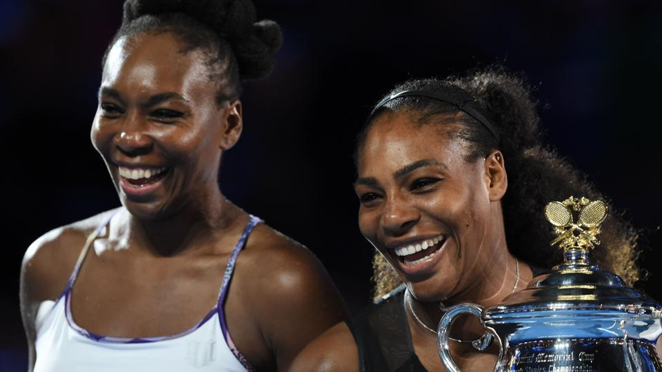 United States' Serena Williams, right, celebrates after winning the Australian Open championship in Melbourne on Saturday. She beat sister Venus Williams 6-4, 6-4