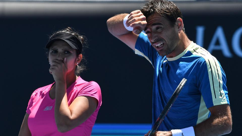 India's Sania Mirza speaks with Croatia's Ivan Dodig during their mixed doubles quarter-final match against Canada's Gabriela Dabrowski and India's Rohan Bopanna in Australian Open in Melbourne on January 25, 2017.