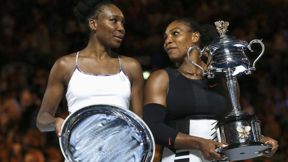 Serena Williams of the U.S. holds her trophy after winning the Australian Open women's singles final match against sister Venus Williams in Melbourne on Saturday.