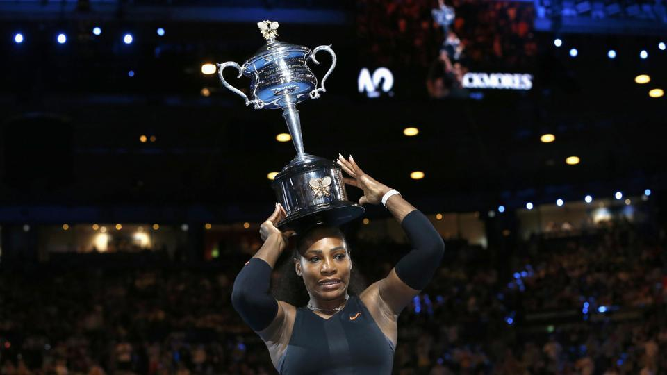Serena Williams places the Australian Open trophy on her head. (REUTERS)